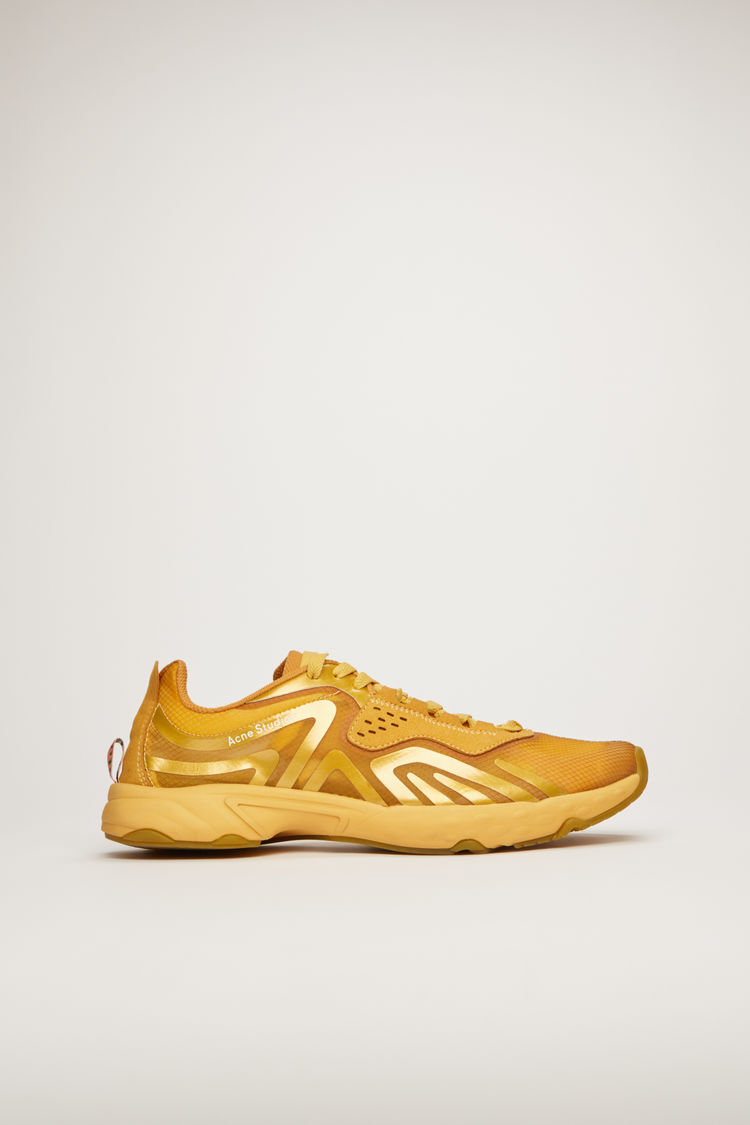 아크네 스튜디오 Acne Studios Trail sneakers gold