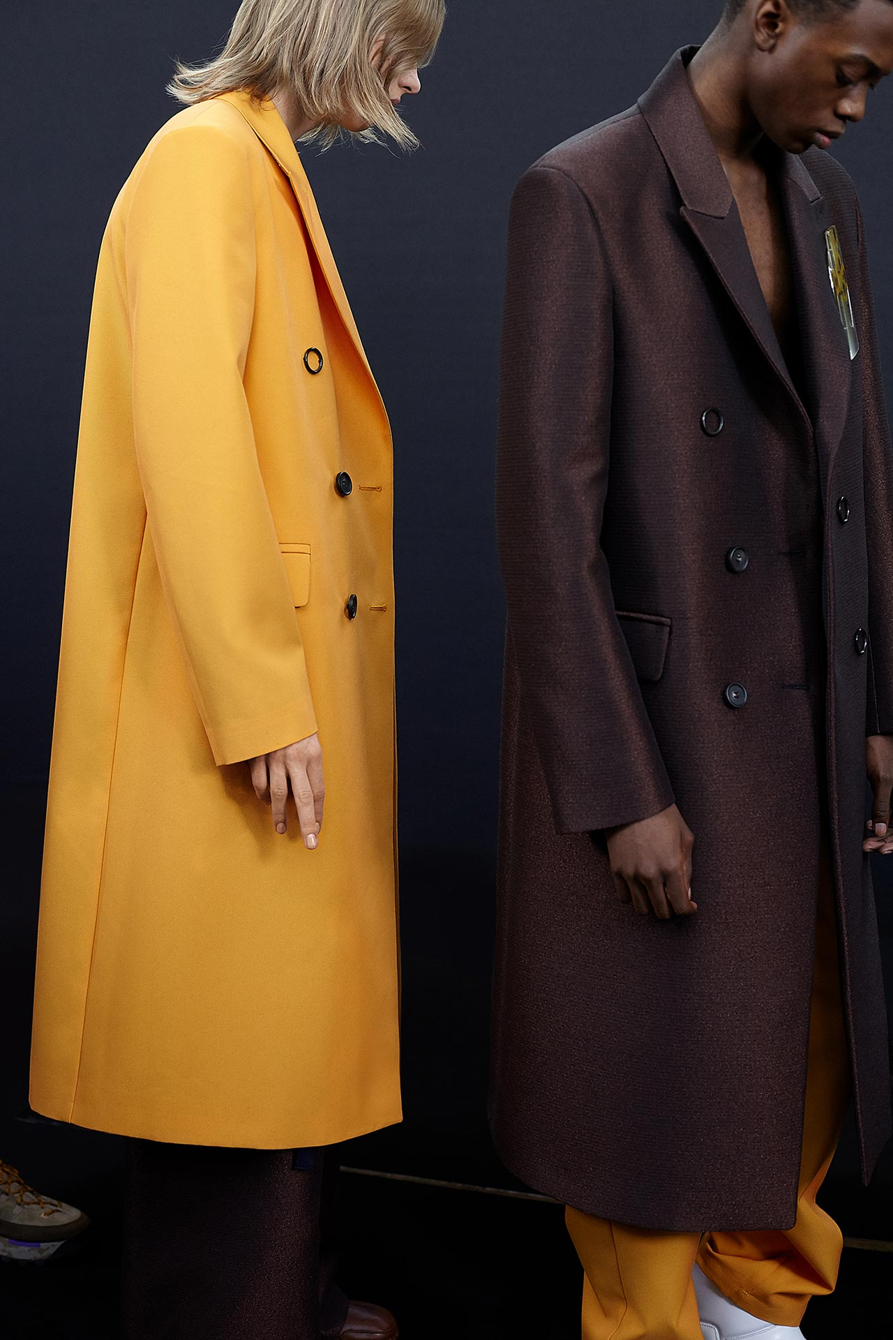 A yellow and a brown coat from the FW19-collection