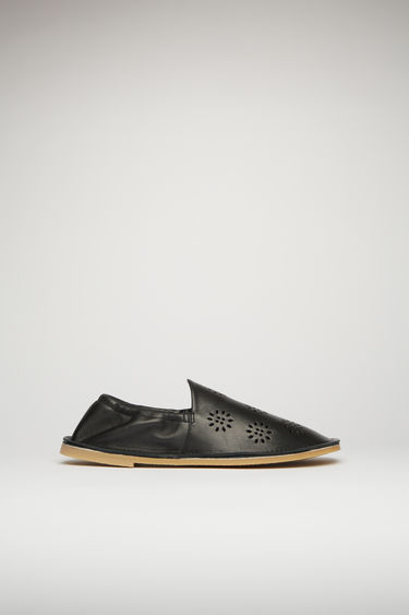 Acne Studios black loafers are crafted from flower-perforated leather to a square-toe silhouette and set on a crepe rubber sole with elasticated cuffs for optimum comfort.