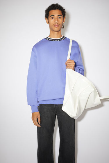 Acne Studios dusty purple sweatshirt is crafted from technical brushed jersey to an oversized fit with dropped sleeves and features Acne Studios logo woven along the neckline.