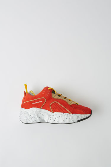 Acne Studios Manhattan Contrast orange/beige sneakers are reinterpreted from the American sportswear of the '90s. They are crafted in a bulky silhouette with a textured upper.  The size runs larger, please size down than usual.