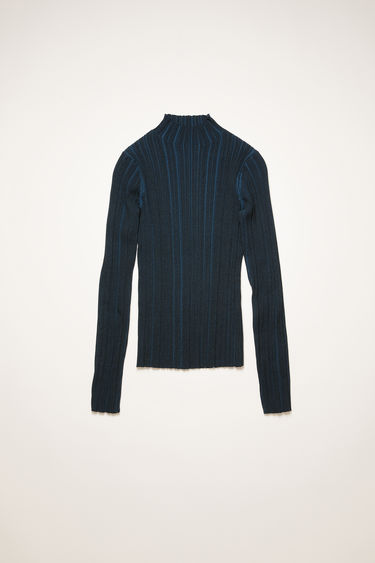 Acne Studios midnight blue mock neck sweater is knitted from mercerized cotton with an irregular ribbed pattern and has a slim-fitting profile.