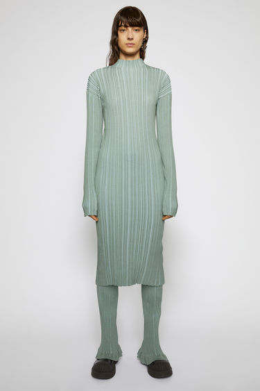 Acne Studios dusty green dress is knitted from mercerized cotton with an irregular ribbed pattern and is shaped to a slim-fitting profile with a mock neckline.