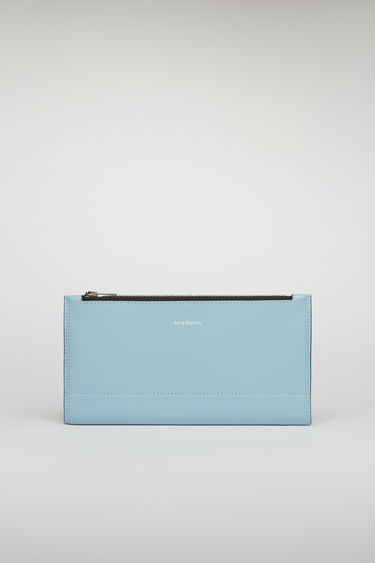 Acne Studios light blue/black continental wallet features a smooth leather construction and it opens to reveal 12 card slots, a zipped pocket and two notes compartment.
