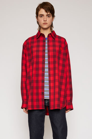 Acne Studios poppy red shirt is cut to a boxy shape with an oversized fit and patterned with a vichy-check design.