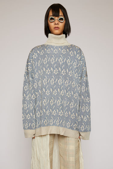 Acne Studios silver roll neck sweater is knitted from a metallic lurex yarn to an oversized fit and feature a floral jacquard pattern and contrasting ribbed trims.