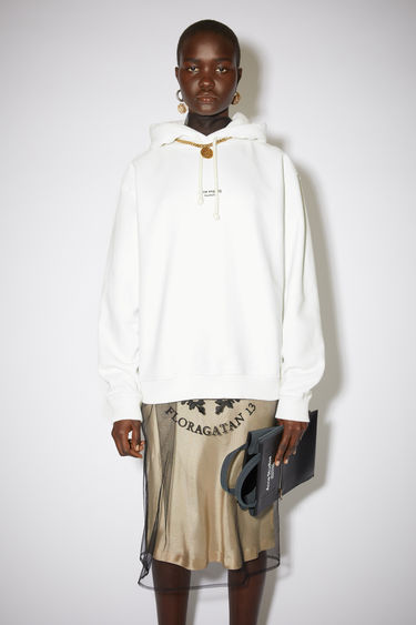 Acne Studios optic white hooded sweatshirt is made from cotton jersey that's been garment dyed for a soft, washed-out finish. It's shaped for an oversized fit and features a reversed logo purposely printed imprecisely across the front.