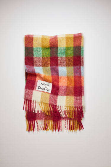 Acne Studios fuchsia/orange multi check blanket is crafted from soft alpaca, wool and mohair and has an upscaled logo label patch stitched at the corner.