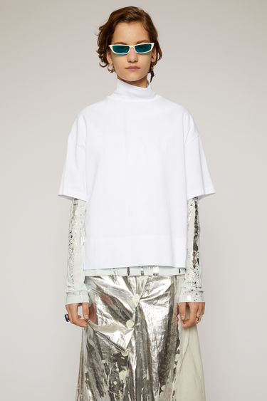 Acne Studios optic white t-shirt is cut from lightweight cotton-jersey to a boxy silhouette and finished with a high ribbed neck and a side slit hem.