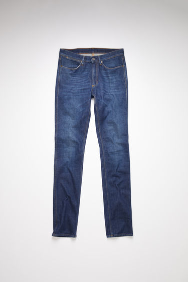 Acne Studios Max Dark Blue jeans are crafted from comfort stretch denim that's faded and whiskered to give a worn-in appeal. They're shaped to sit low on a waistband before falling to slim legs.