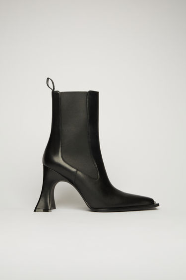 Acne Studios black ankle boots are crafted from soft grained leather and designed with a pointed toe and curved block heel, then detailed with elasticated side panels and a looped heel tab.