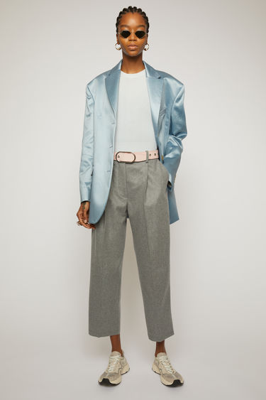 Acne Studios platinum grey melange trousers are cut to sit high on the waist and shaped to a tapered-leg fit with front pleats.