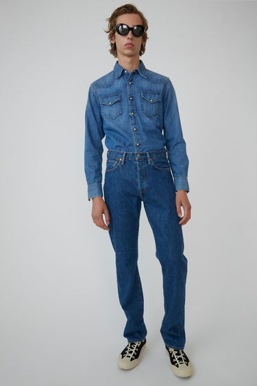 Acne Studios 2001 Mid Blue Trash denim shirt is crafted from lightweight denim and finished with a point collar and snap buttons.