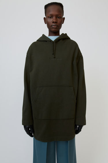 Acne Studios forest green hoodie dress is shaped to an oversized fit and accented with a debossed logo on the front.