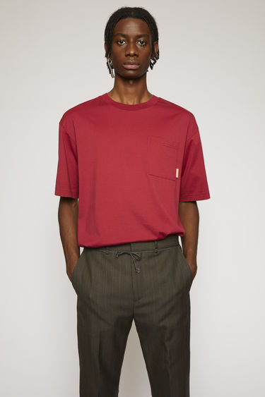 Acne Studios burgundy t-shirt is cut to a boxy silhouette from soft cotton jersey and completed with a ribbed collar and a chest patch pocket.