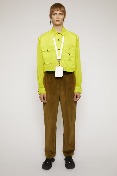 Acne Studios olive green corduroy trousers are cut to a carrot-leg fit with single front pleats and finished with wide belt loops and back patch pockets.