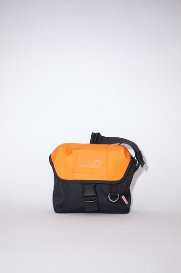 Acne Studios black/orange brightly coloured crossbody bag features a clear cardholder on the front and Acne Studios logo.