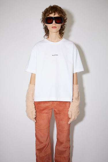 Acne Studios optic white short sleeve t-shirt features a ribbed crew neck and an Acne Studios logo at the chest.
