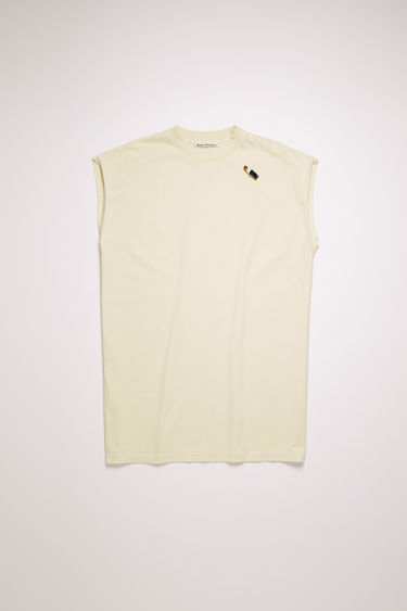 Acne Studios cream beige tank top is crafted to an oversized fit from midweight cotton jersey and features a detachable jewelled brooch on the chest.