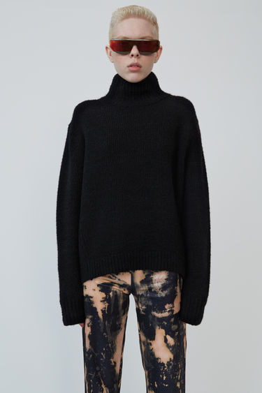 Acne Studios black high neck sweater with slanted side seams to create a cocoon-like silhouette.