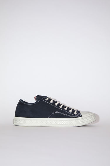 Acne Studios black/off white distressed canvas lace-up sneakers have rubber toes and soles.