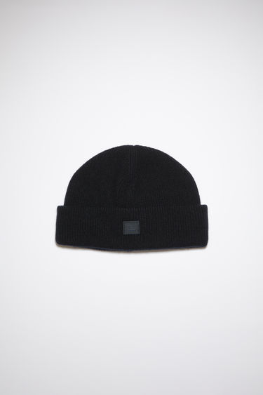 Acne Studios black beanie is knitted with wool and lycra for a closer fit and accented with a small tonal face-embroidered patch on the turn-up.