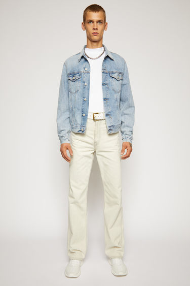 Acne Studios 1998 Light Blue Trash denim jacket is crafted from rigid denim with a light stone wash. It is finished with chest flap pockets and untrimmed buttonholes.