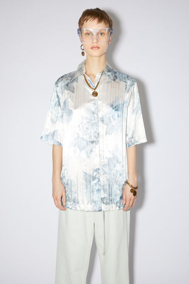 Acne Studios blue pleated, floral print shirt has a relaxed fit with button closures.