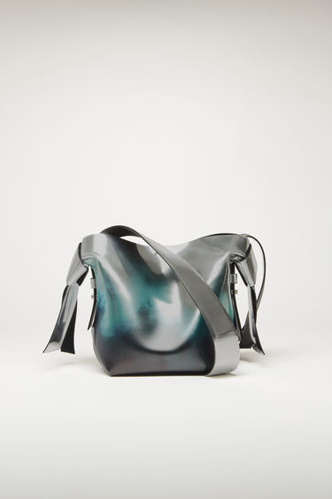 Acne Studios Musubi Mini silver/green bag is crafted from metallic-effect leather with a patina-worn finish and accented with a twisted knot along each side of the bag.