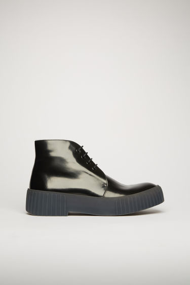 Acne Studios black/grey shoes are shaped to a classic chukka silhouette. They're crafted from polished leather to a high-top silhouette and set on a chunky ribbed-rubber sole.