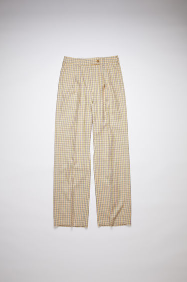 Acne Studios yellow/brown wide leg suit trousers are made of a cotton blend tweed with large pleats.