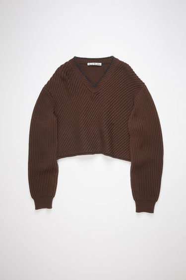 Acne Studios dark brown v-neck sweater is made of a chunky, bias rib knit with a cropped fit.