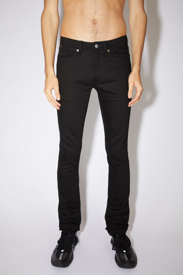 Acne Studios black/black jeans are made from comfort stretch denim with a low rise and a slim leg.