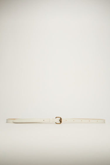 Acne Studios cold white belt is cut slim from high-shine leather and features an antiqued gold-tone buckle.