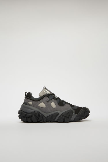 Acne Studios Bolzter W faded black sneakers are crafted from mesh with faux-suede overlays, and set on chunky tread soles.