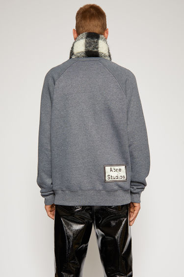 Acne Studios navy blue sweatshirt is crafted from melange loopback jersey and has a reversed label patch at the lower back.