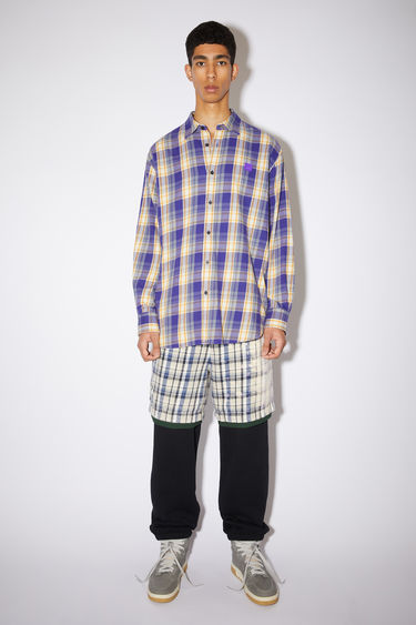 Acne Studios purple/mustard yellow relaxed button down shirt is made of organic cotton flannel with a face patch at the chest.