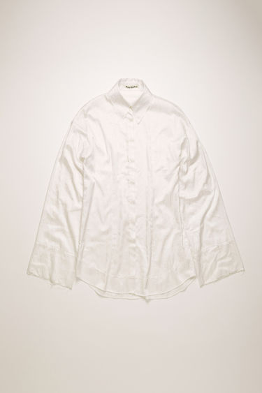 Acne Studios ivory white shirt is crafted from satin and patterned with a floral print reminiscent of vintage wallpapers. It features a point collar and wide cuffs and raw-edged trims.