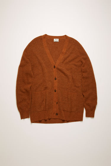 Acne Studios cognac brown cardigan is crafted in a full cardigan stitch from an alpaca and wool blend and shaped to a relaxed fit with exposed seams running along the shoulders.