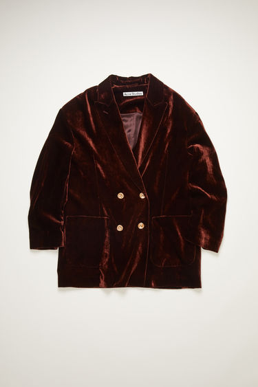 Acne Studios dark brown velvet jacket is cut generously throughout the body with a double-breasted front and has peak lapels and front patch pockets.