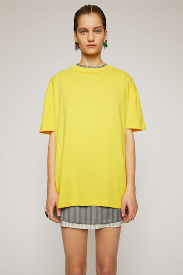 Acne Studios canary yellow t-shirt is crafted to a boxy silhouette from slubbed cotton and adorned with a large-scale label patch that's left with loose threads for a subtle note of texture.