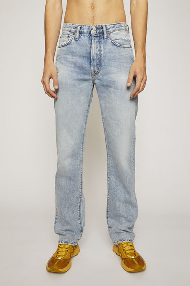 Acne Studios 1996 Light Blue Trash jeans are crafted from rigid denim that's washed to give a worn-in appeal. They're shaped to a high-rise silhouette with loose, straight legs and accented with subtle whiskering and fading.