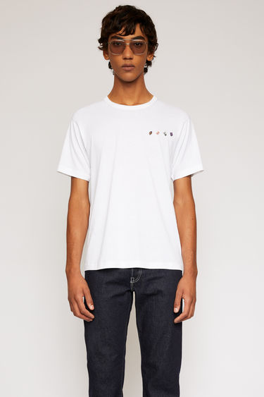 Acne Studios optic white t-shirt is crafted from lightweight cotton jersey and accented with safari animal pins across the front.