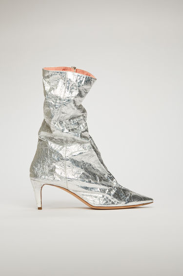Acne Studios silver boots are crafted to a pointed toe set on a kitten heel and accented with a two-way metal zip.