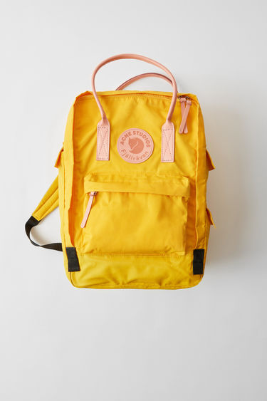 "Acne Studios Kånken Tarpaulin A/F sunflower yellow is a variant on the Kånken 15"" laptop bag, updated with luxury finishes. A collaboration between Fjällräven and Acne Studios, with co-branded details."