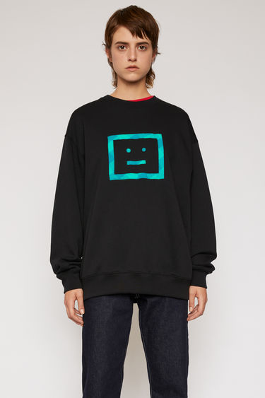 Acne Studios black sweatshirt is crafted from midweight loopback fleece and features a face motif stitched across the front.