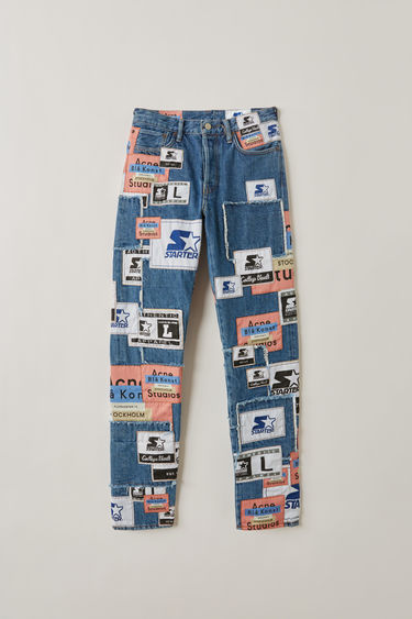 Acne Studios 1996 Collab Patch mid blue are classic fit, 5 pocket jeans with a bold collage of logo patches. A collaboration between Acne Studios Blå Konst and Starter Black Label .