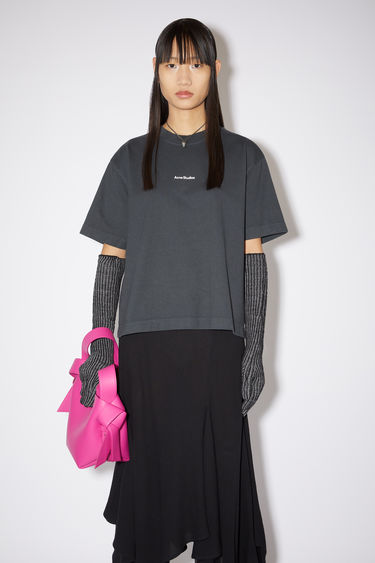 Acne Studios black t-shirt is made from cotton jersey that has been garment dyed for a soft, washed-out finish and features a reversed logo printed across the chest.