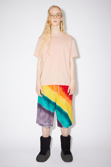 Acne Studios powder pink crew neck t-shirt is made from cotton with a regular fit and a face logo patch.