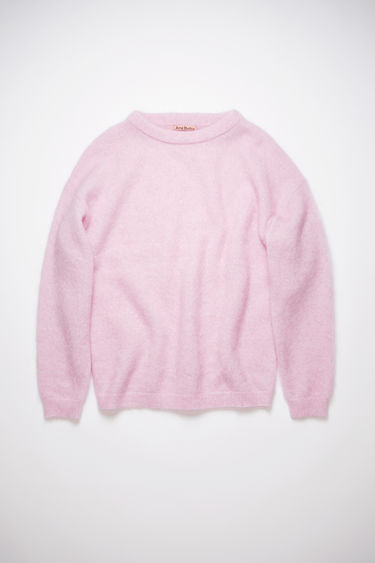 Acne Studios bubblegum pink sweater is knitted from soft wool and mohair-blend yarn and has a ribbed crew neckline and dropped shoulders to create a relaxed silhouette.